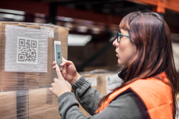 Woman reading the barcode with the mobile phone app stock photo
