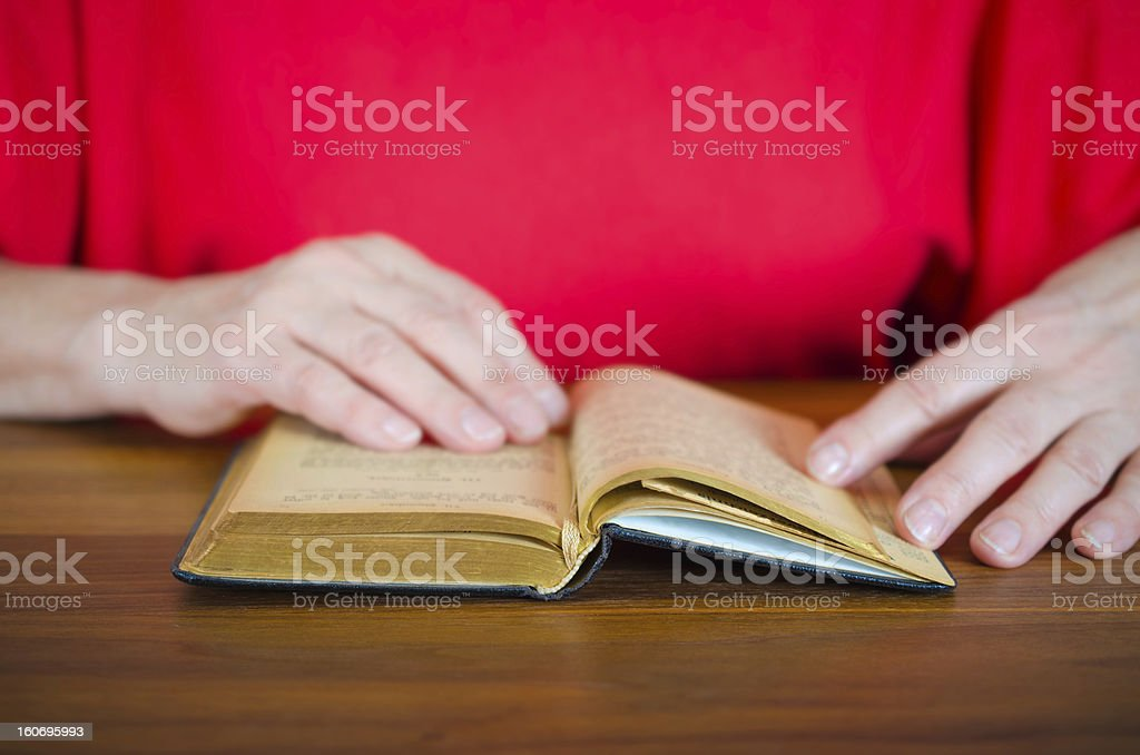 Woman reading the bible royalty-free stock photo