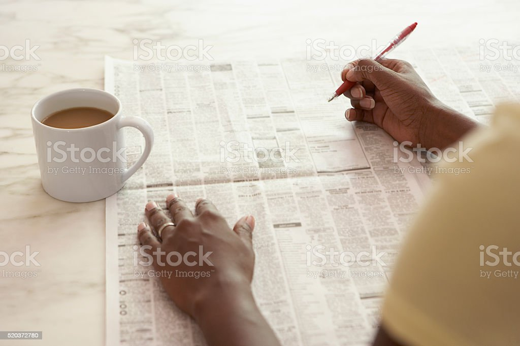 Woman reading the classified ads stock photo