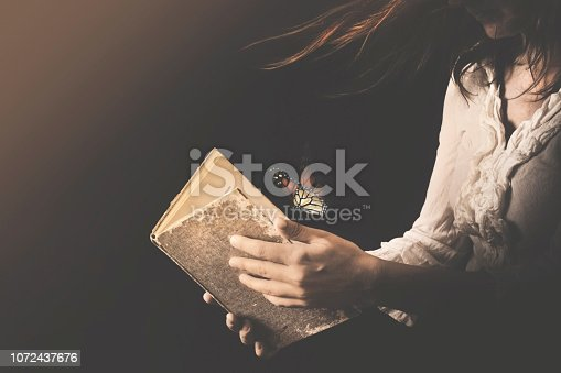 woman reads a book where butterflies go out
