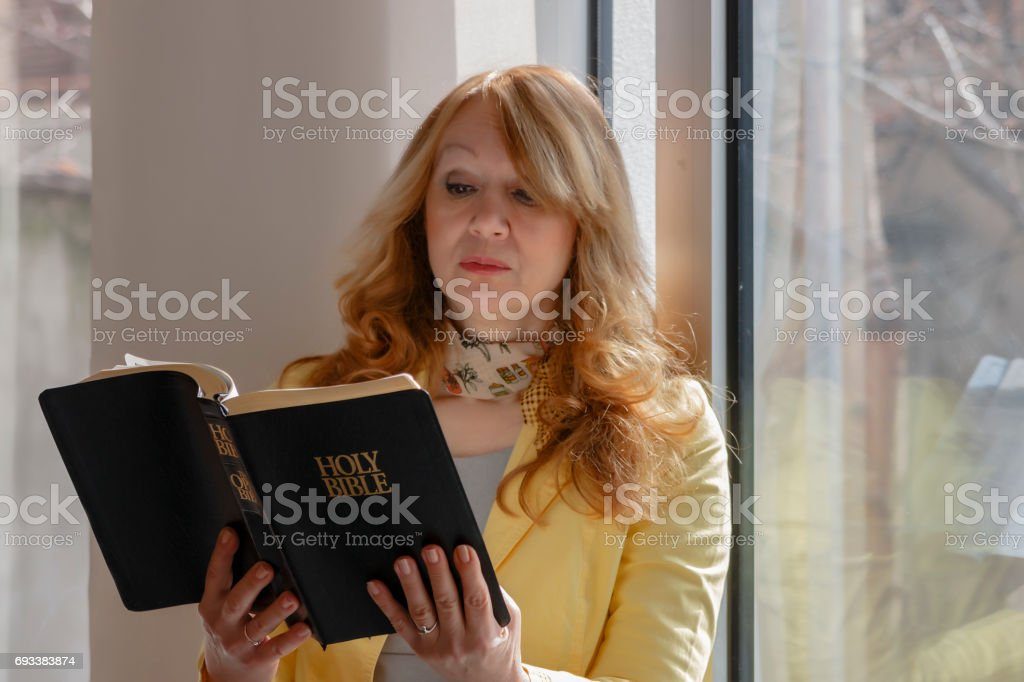 Woman reads the Bible stock photo