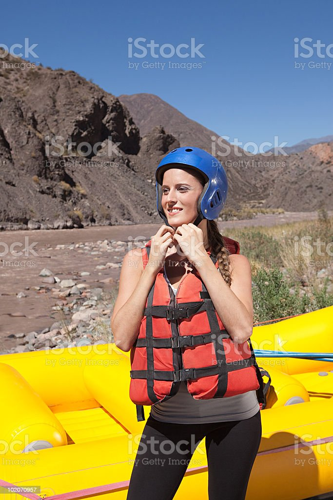 Woman ready for white water rafting royalty-free stock photo