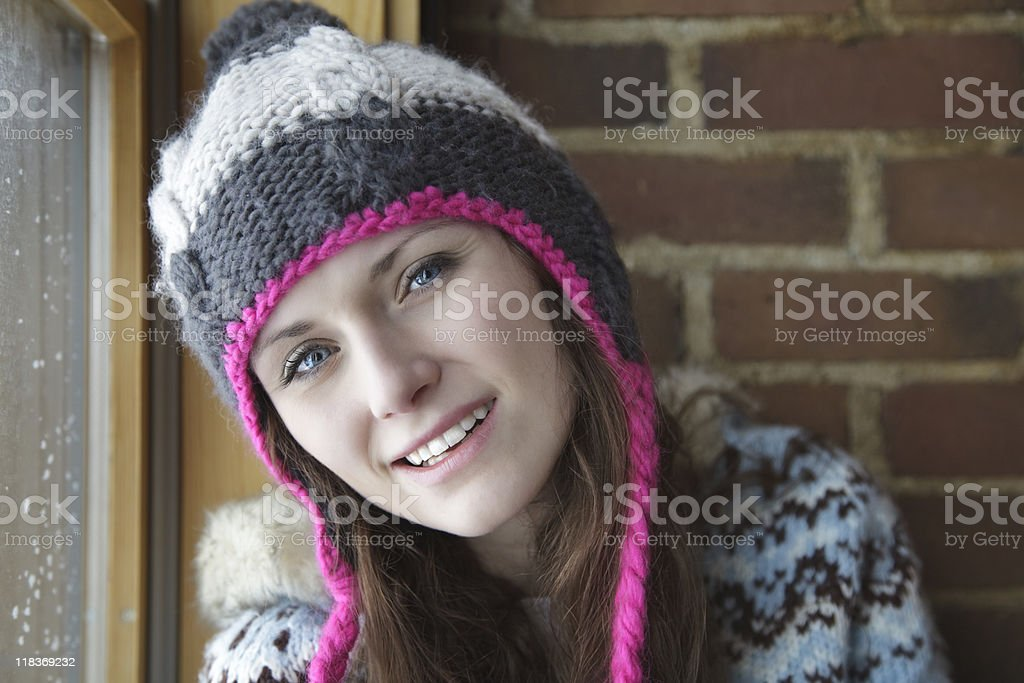 Woman Ready for Winter in a Knit Cap and Jacket royalty-free stock photo
