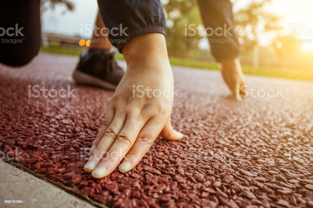Woman ready start running stock photo