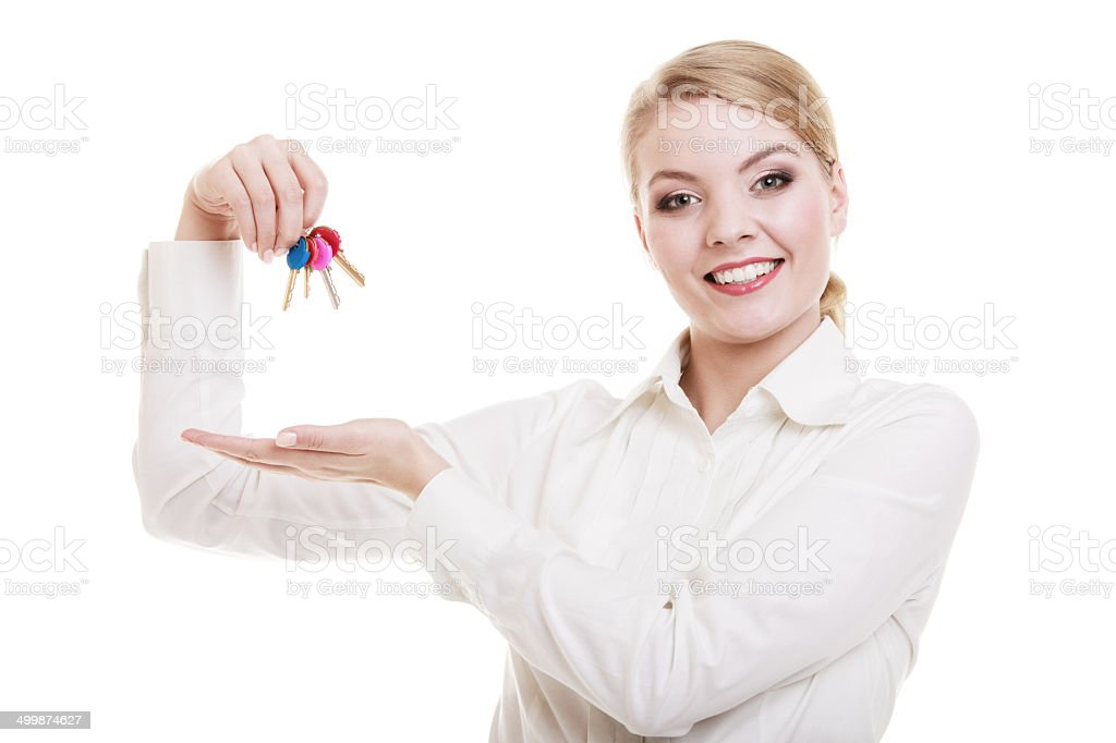 Woman real estate agent holding set keys to new house stock photo