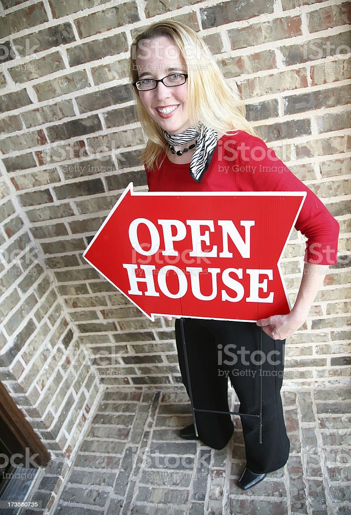 Woman Realtor Holding Open House Sign royalty-free stock photo