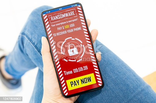 1008108222 istock photo Woman receive ransomware message 1247805902