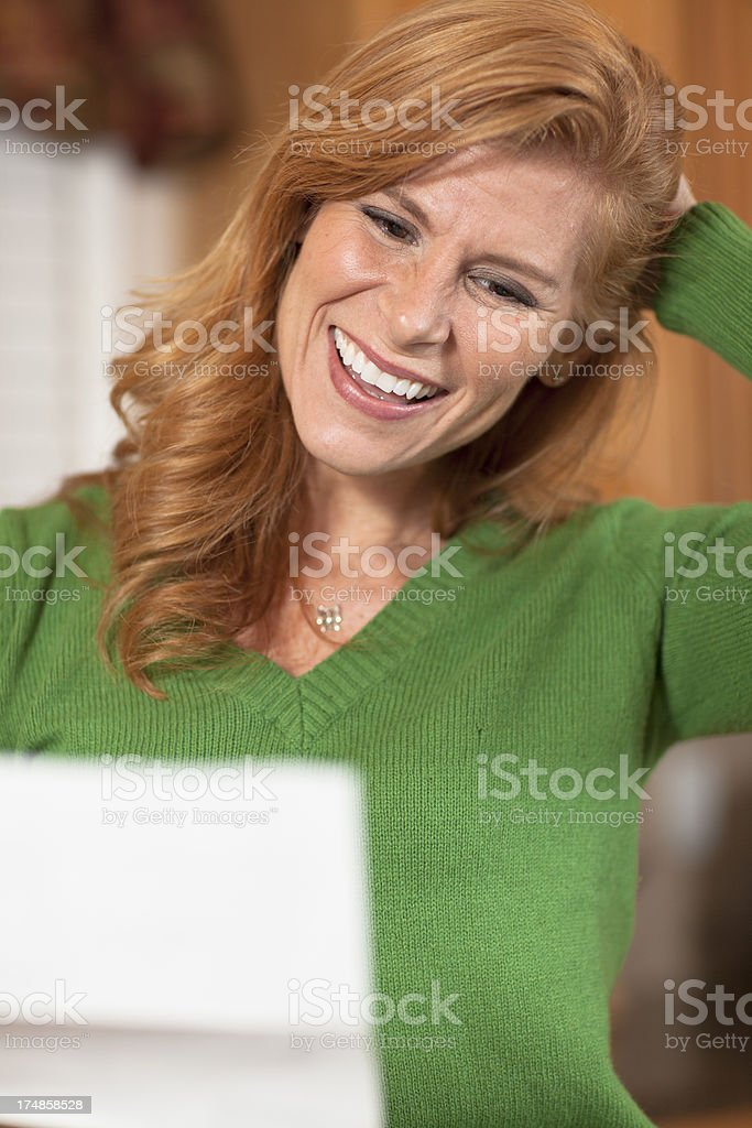 Woman receives a letter with good news royalty-free stock photo