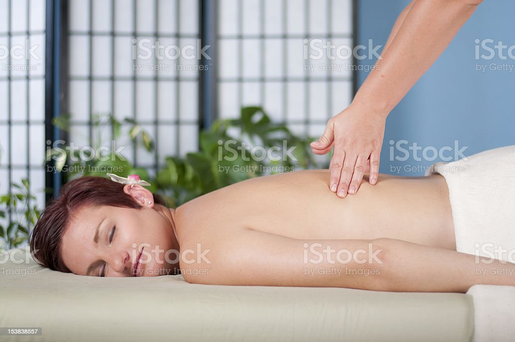 Woman Receives Back Massage royalty-free stock photo