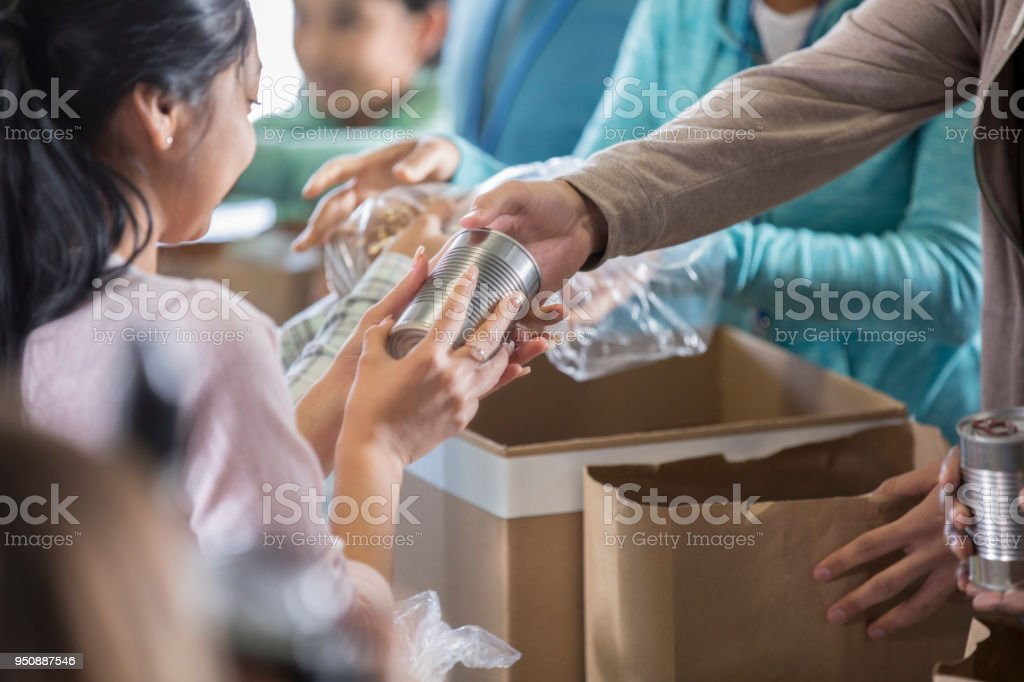 Woman receives food from local food bank stock photo
