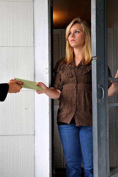 Woman Receives Hand-Delivered Document stock photo