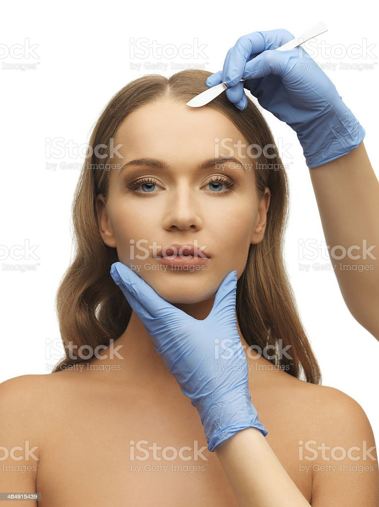 Woman receiving a face treatment at a beauty center stock photo