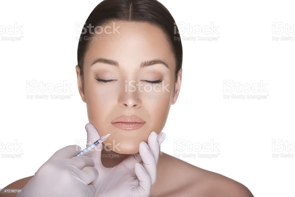 A woman receiving a facial infection stock photo