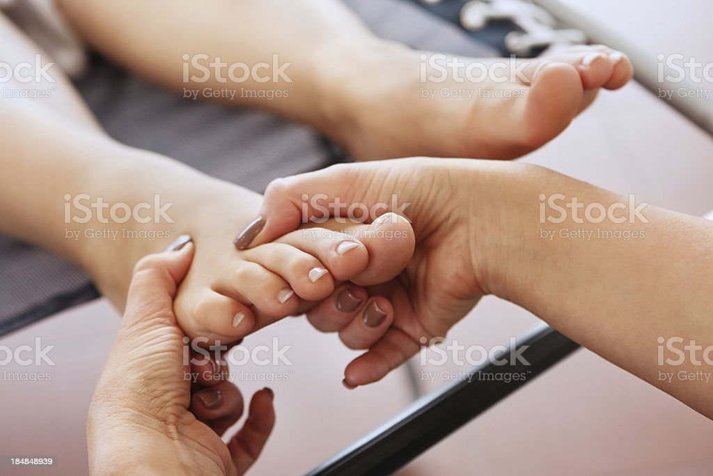 Woman Receiving a Foot Massage royalty-free stock photo