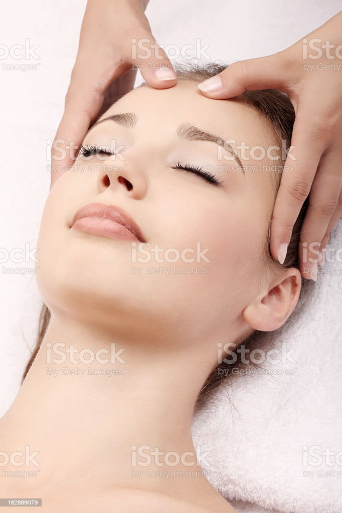 A woman receiving a head massage stock photo