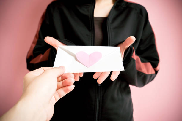 Woman receiving a love letter picture id824154664?b=1&k=6&m=824154664&s=612x612&w=0&h=fnnlgypzxe6q8isi6 q2 bxtxr4rfwzsnw6bqafggo0=