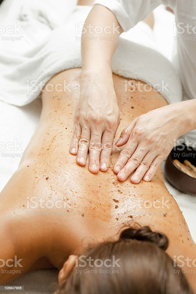 A woman receiving a massage at a spa stock photo