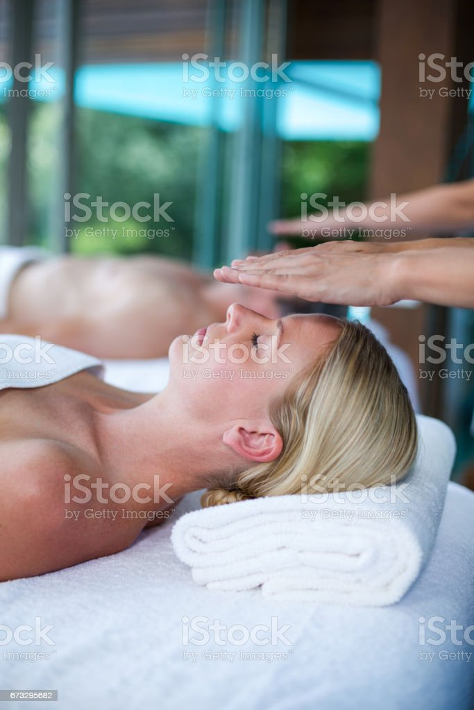 Woman receiving a massage from masseur royalty-free stock photo