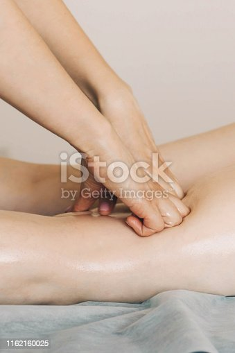 istock Woman receiving a massage in a medical center. 1162160025
