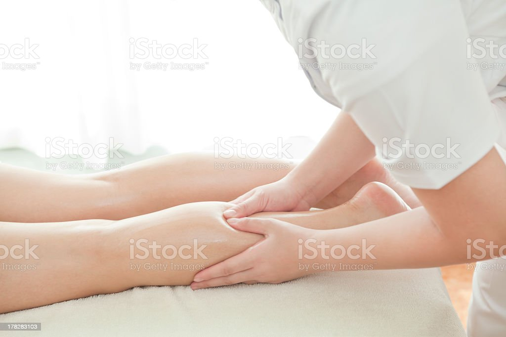 Woman receiving a massage to her legs royalty-free stock photo