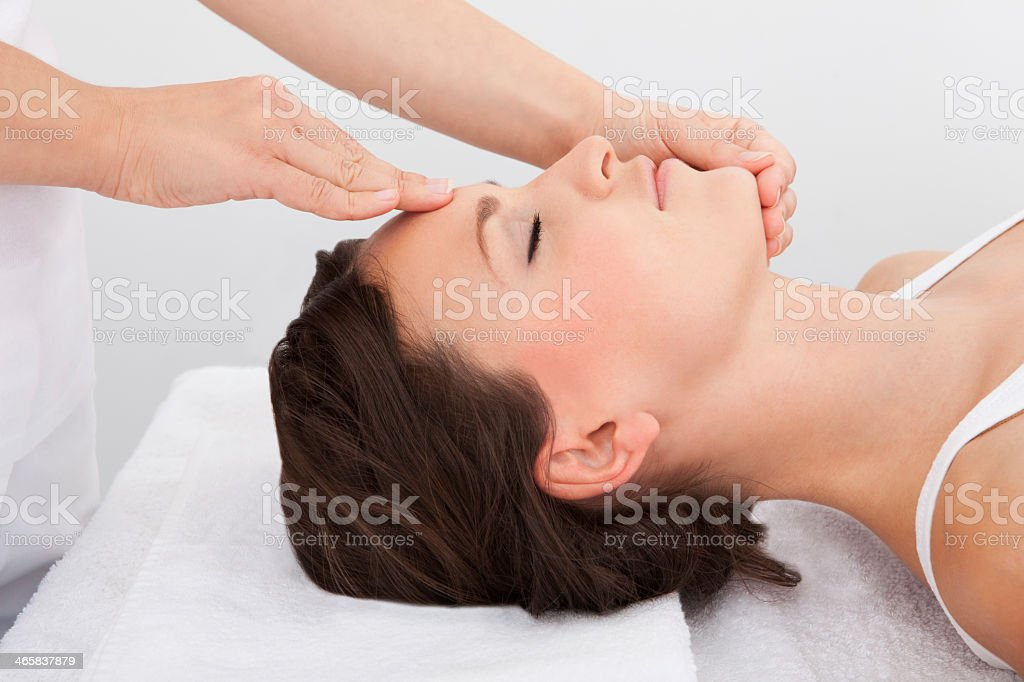 Woman receiving a massage while lying down stock photo