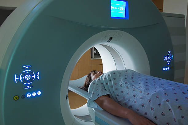 Woman Receiving a medical Scan for Breast Cancer Diagnosis stock photo