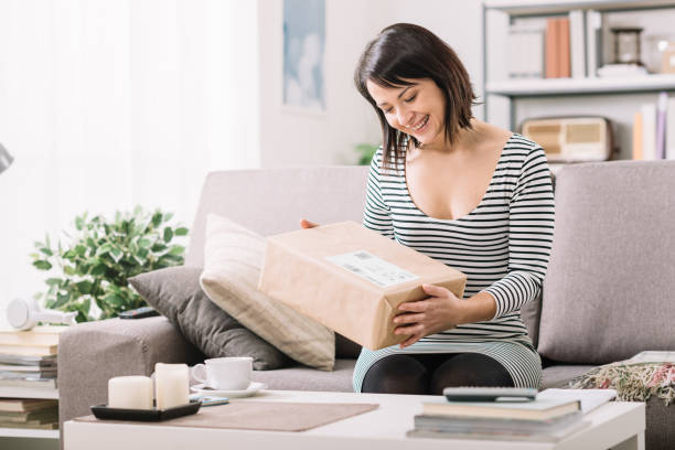Woman receiving a parcel stock photo