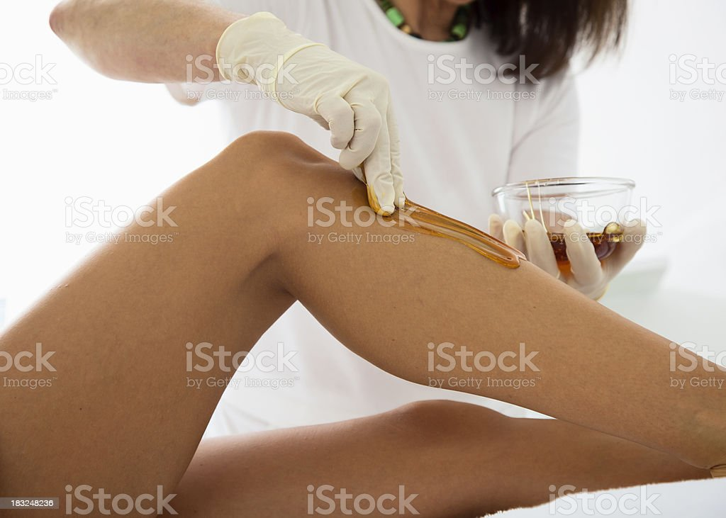Woman Receiving a Waxing Treatment royalty-free stock photo