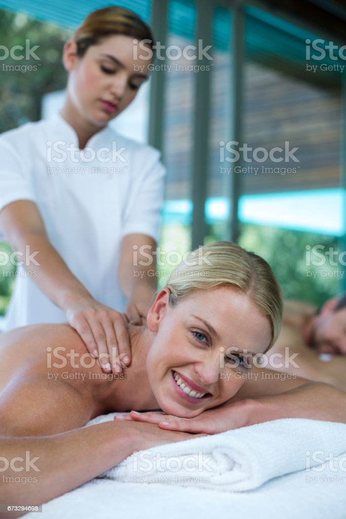 Woman receiving back massage from masseur royalty-free stock photo