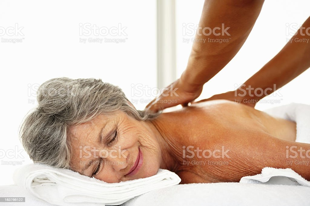 Woman receiving back massage royalty-free stock photo