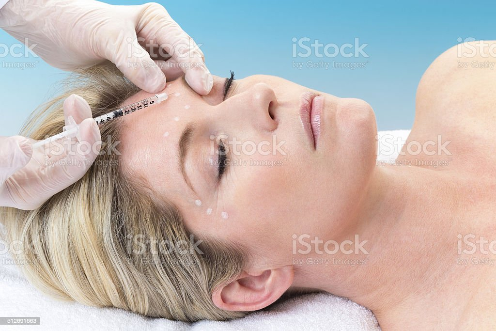 Woman Receiving Botox Injection stock photo
