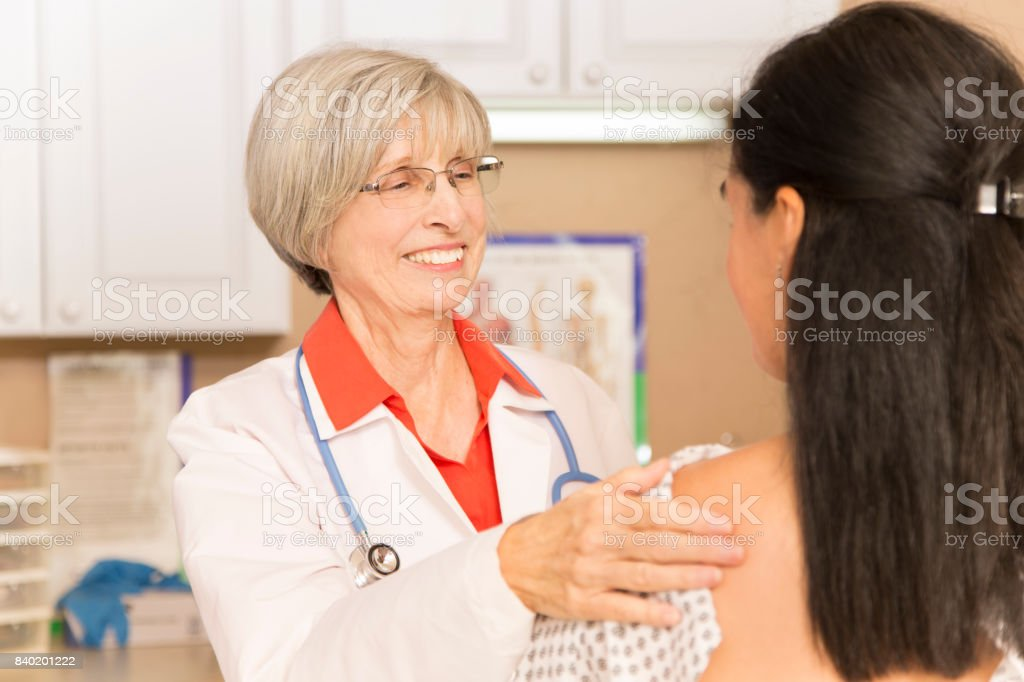 Woman receiving breast exam, mammogram at doctor's office or hospital. stock photo
