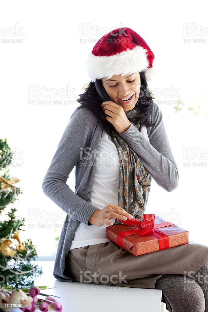 woman receiving Christmas present royalty-free stock photo