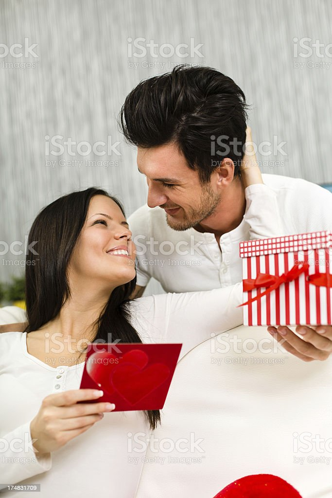 Woman receiving gift and greeting card royalty-free stock photo