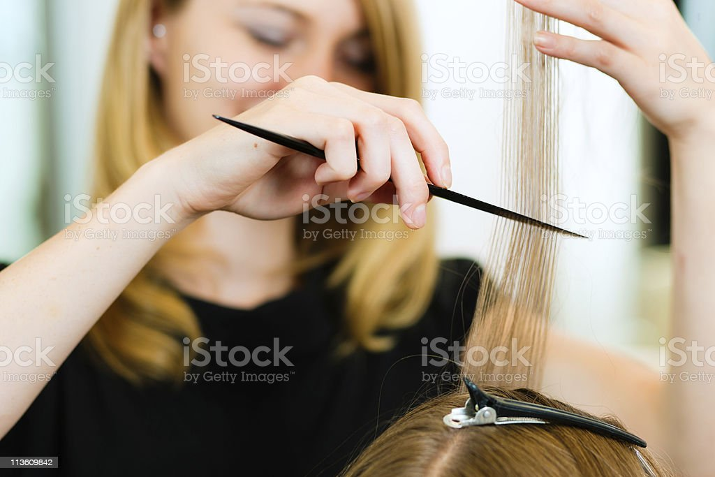 Woman receiving haircut royalty-free stock photo