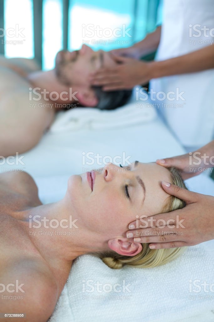 Woman receiving head massage from masseur royalty-free stock photo