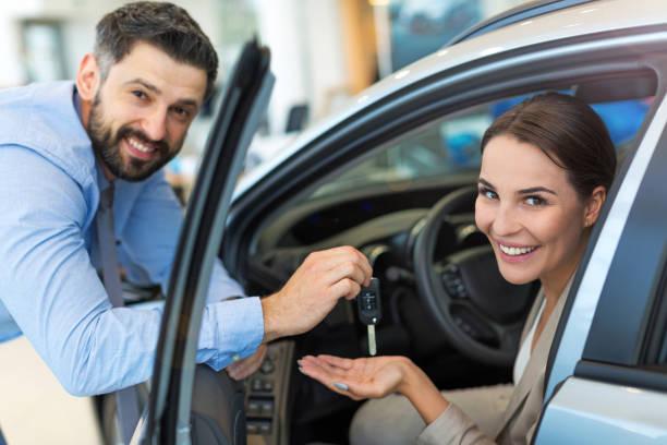 Woman receiving keys from a car dealer picture id700661546?b=1&k=6&m=700661546&s=612x612&w=0&h=gigfnpyzqyz2mqpqwbe07vehjbsir5sunr6vyr1h2ia=