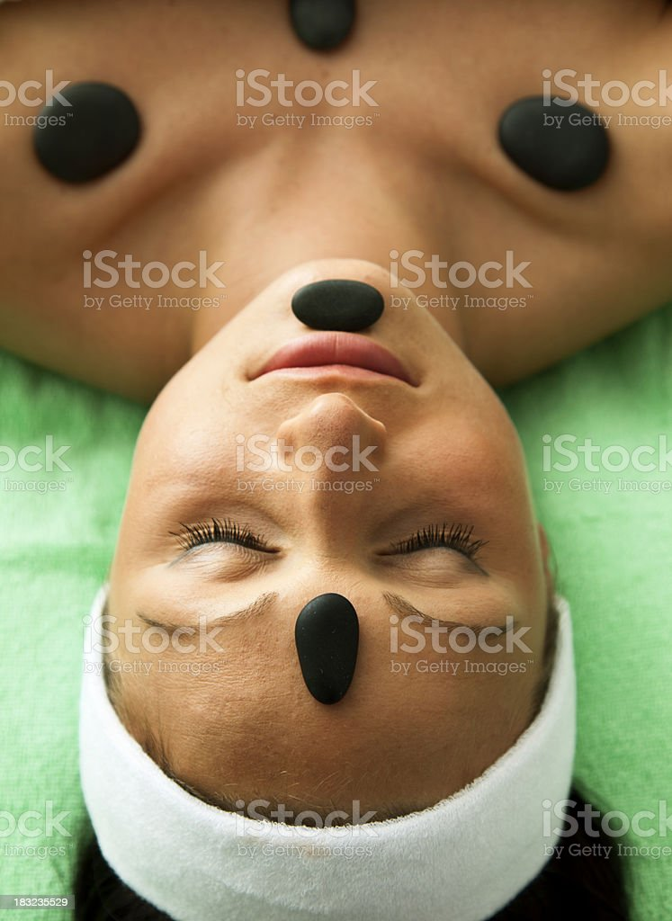 Woman Receiving LaStone Therapy royalty-free stock photo