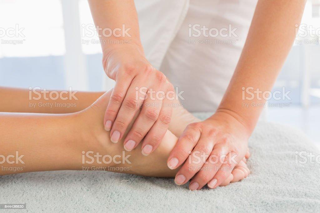 Woman receiving leg massage at spa center stock photo