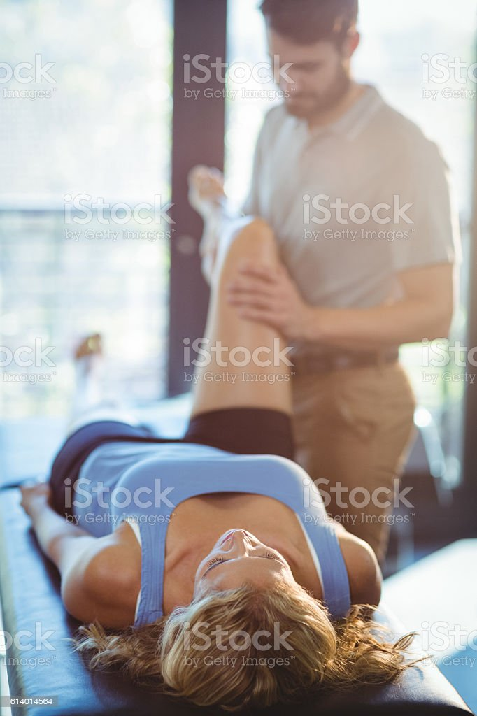 Woman receiving leg massage from physiotherapist stock photo