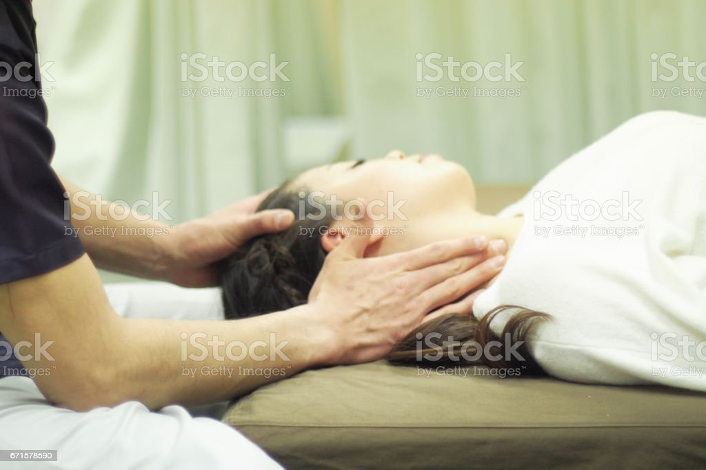 Woman receiving massage on neck stock photo