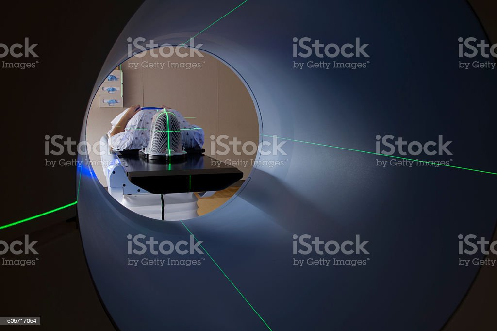 Woman Receiving Medical Scan for Brain Tumor royalty-free stock photo