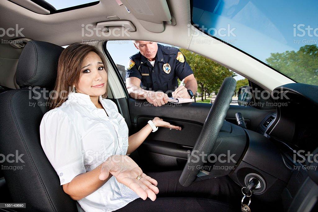 Woman Receiving Moving Violation stock photo