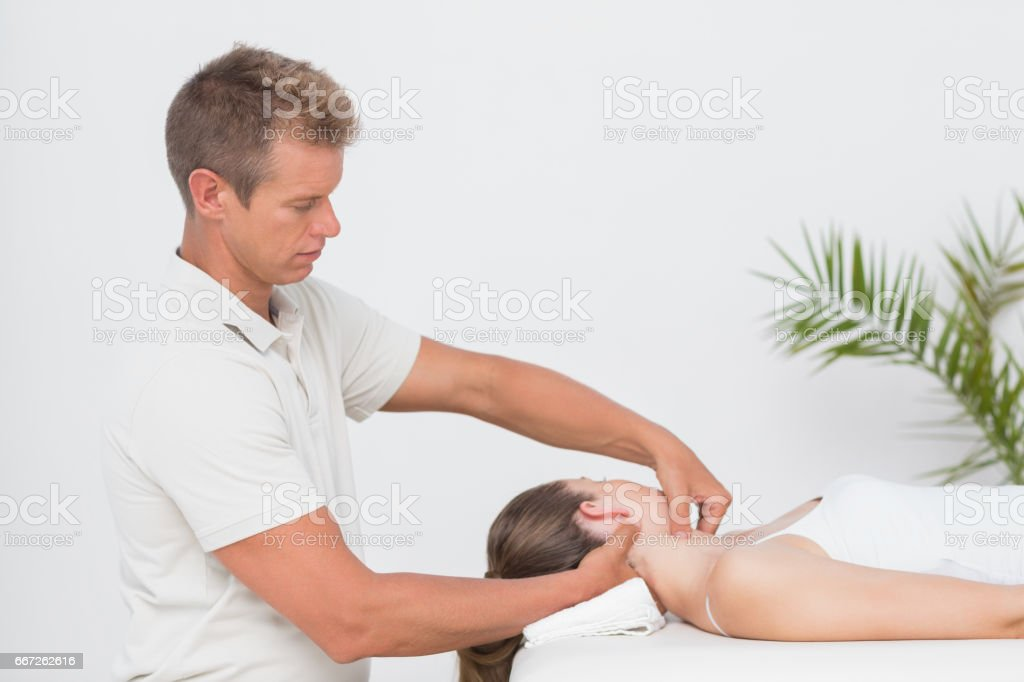 Woman receiving neck massage stock photo