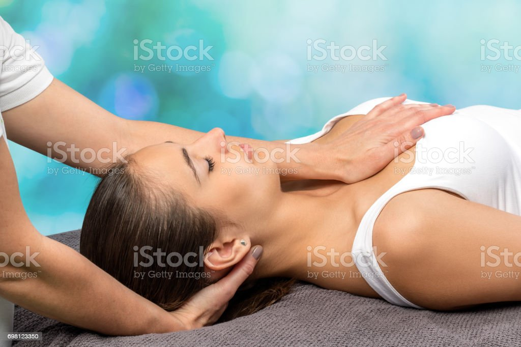 Woman receiving physio therapy on neck and chest. stock photo