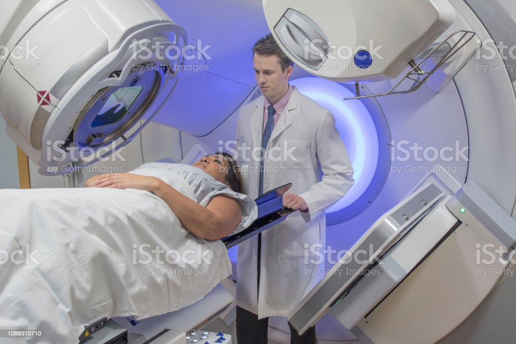 Woman Receiving Radiation Therapy Treatments for Breast Cancer stock photo