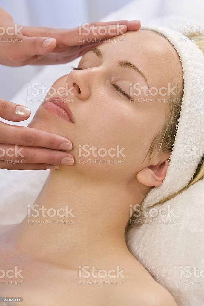 Woman Receiving Relaxing Head Massage Facial Treatment At Health Spa royalty-free stock photo