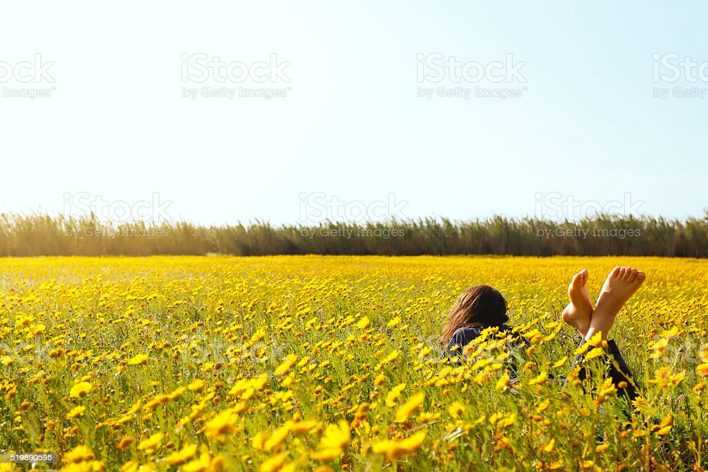 Woman reclining in the grass. stock photo