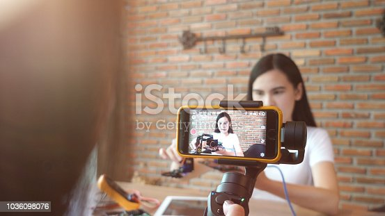 WoMan recording video for DIY stuff preparation