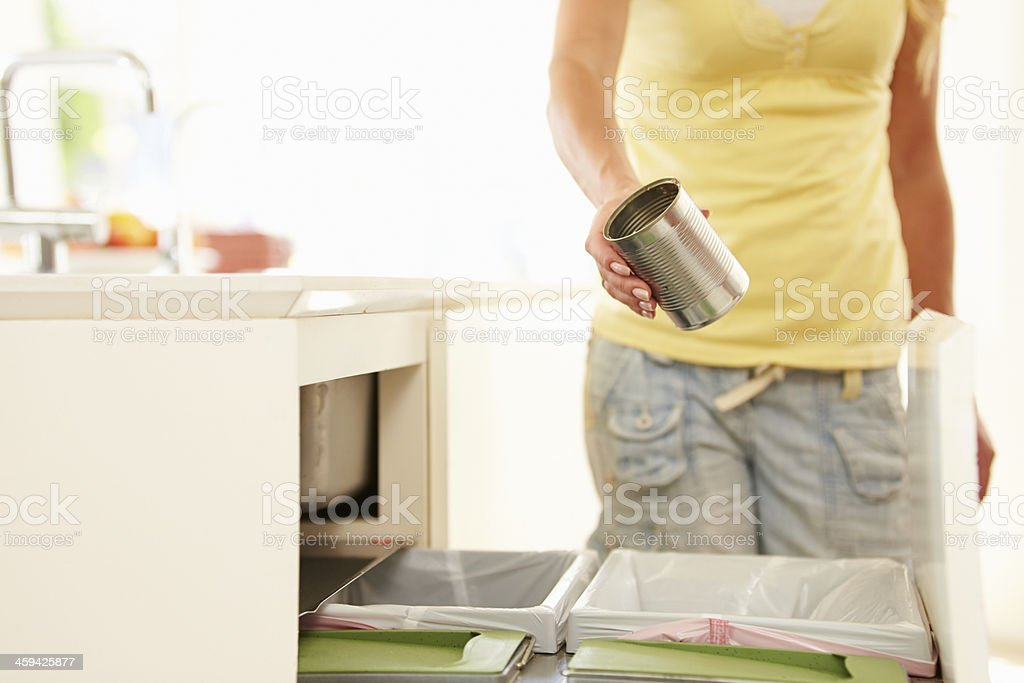 Woman Recycling Kitchen Waste In Bin stock photo